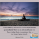 man sitting on a log at the beach contemplating- soul-searching and truth-seeking